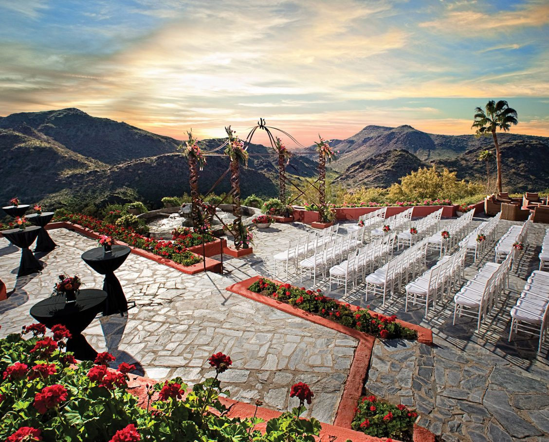 Outdoor wedding ceremony on the patio at Different Pointe of View restaurant with gorgeous mountain views