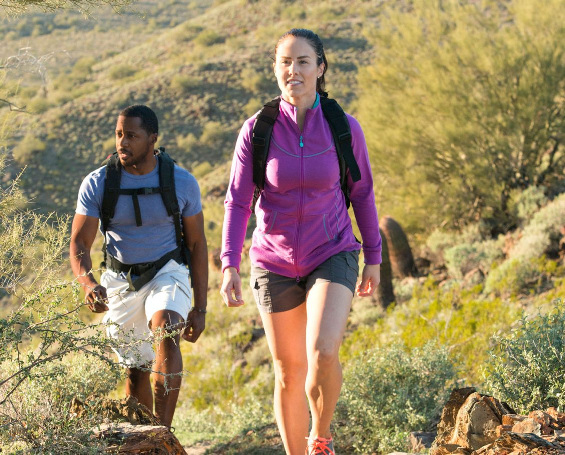 Man and woman hiking on desert trail