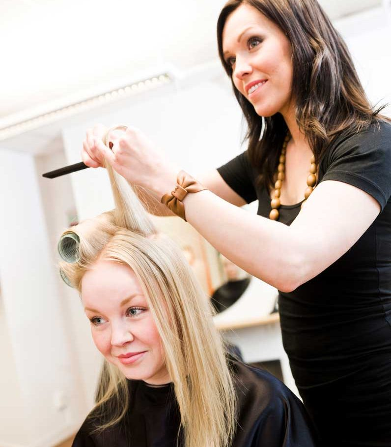 Hairdresser in a salon styling a clients hair
