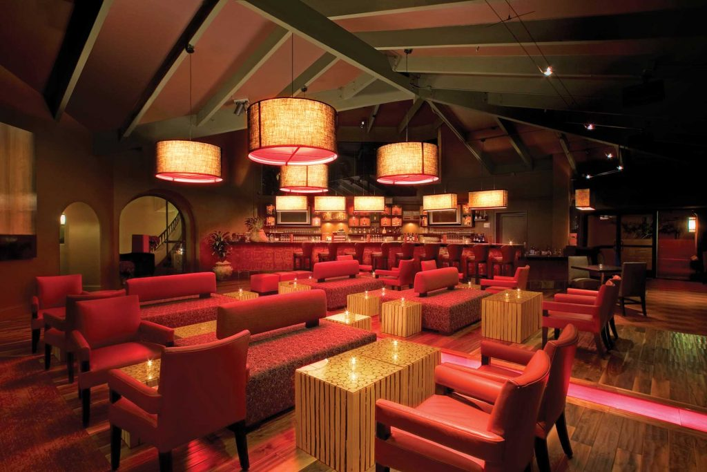 Photo of The Terrace Room lounge showcasing a full bar with modern seating and accent lighting
