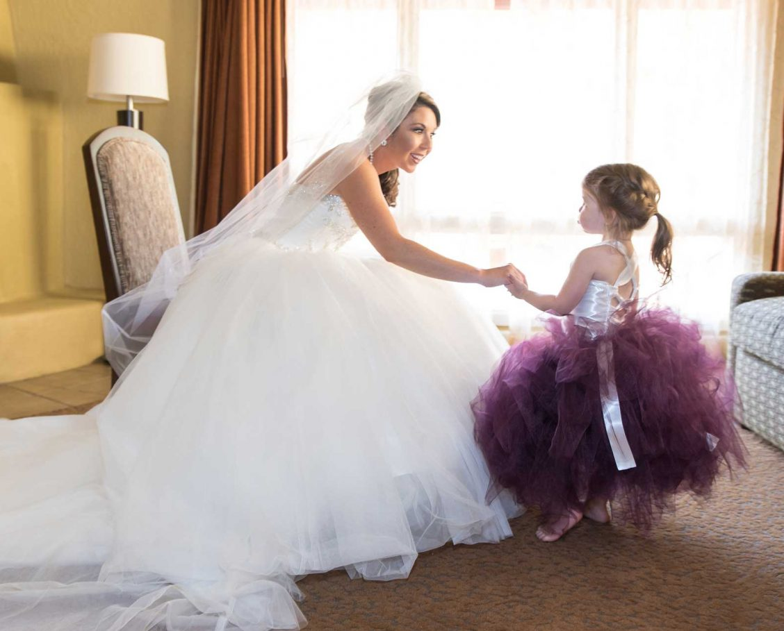 Bride and flower girl getting ready in a suite
