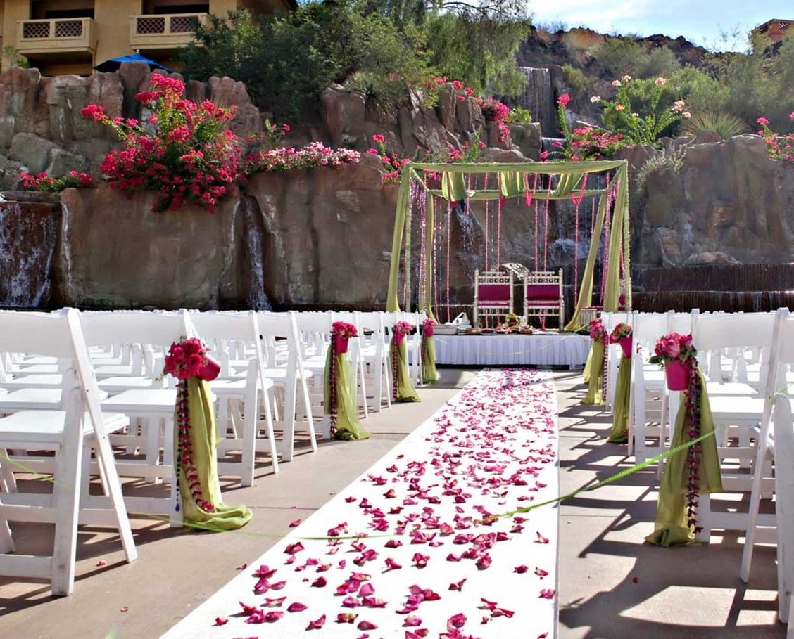 Outdoor wedding ceremony set-up next to flowing waterfalls